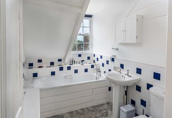 Second floor bathroom with restricted ceiling and church views.