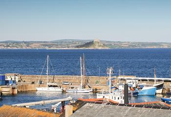 Sit back and take in the view over Penzance harbour and St Michael's Mount from the dining table.