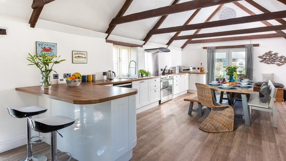 This large kitchen dinner is perfect for hosting, we love the exposed beams!