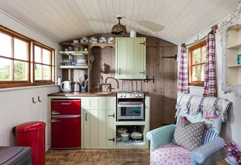 Although only little, the kitchen is well-equipped for two people to enjoy their stay. The door to the right of the kitchen leads to the shower room.