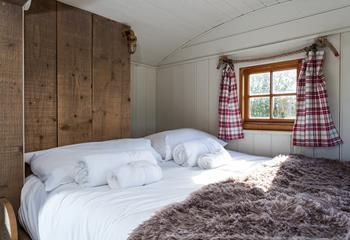 Wake up to a beautiful Cornish view from the comfy and cosy double bed at the back of the shepherd's hut.