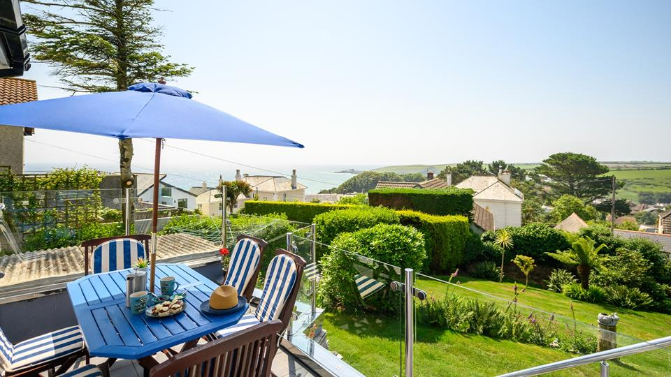 Enjoy a cream tea with views of the glistening Cornish sea.