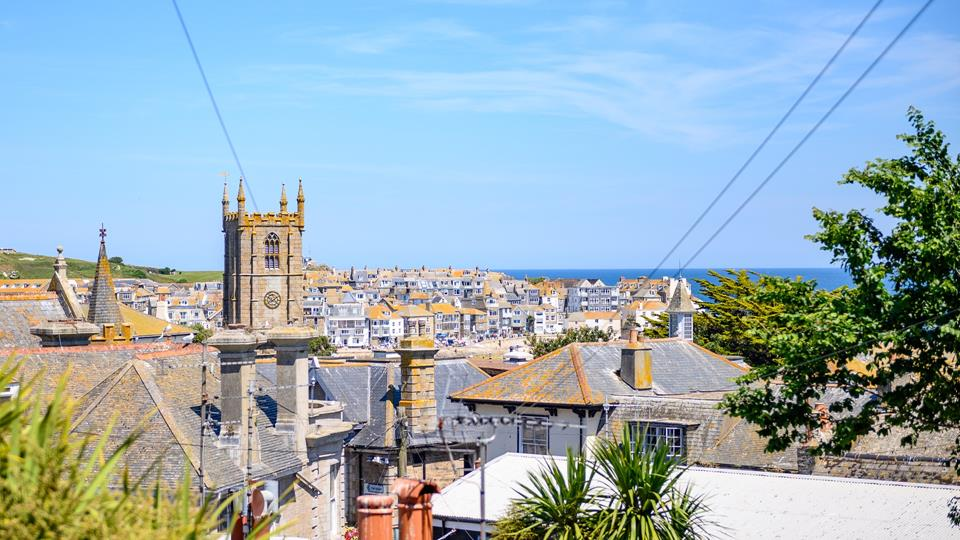 St Ives is a seaside town with great architecture and atmosphere, church tower, spires, chimneys and rooftops flow to the harbour and the sea.