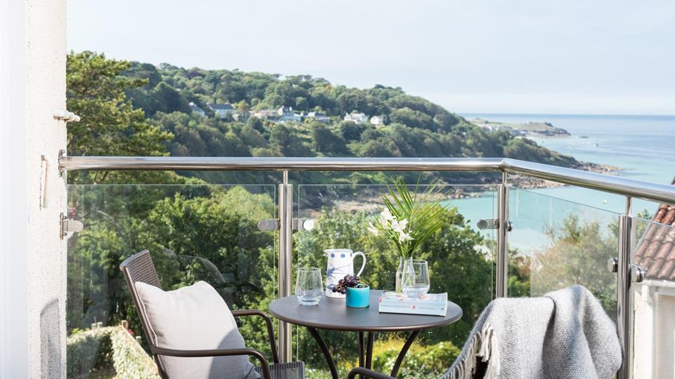 The private balcony has a stunning view of the rugged coastline.