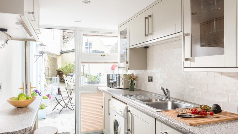 Practical and spacious, the kitchen also has a washing machine so you can keep on top of your laundry while you're staying here.