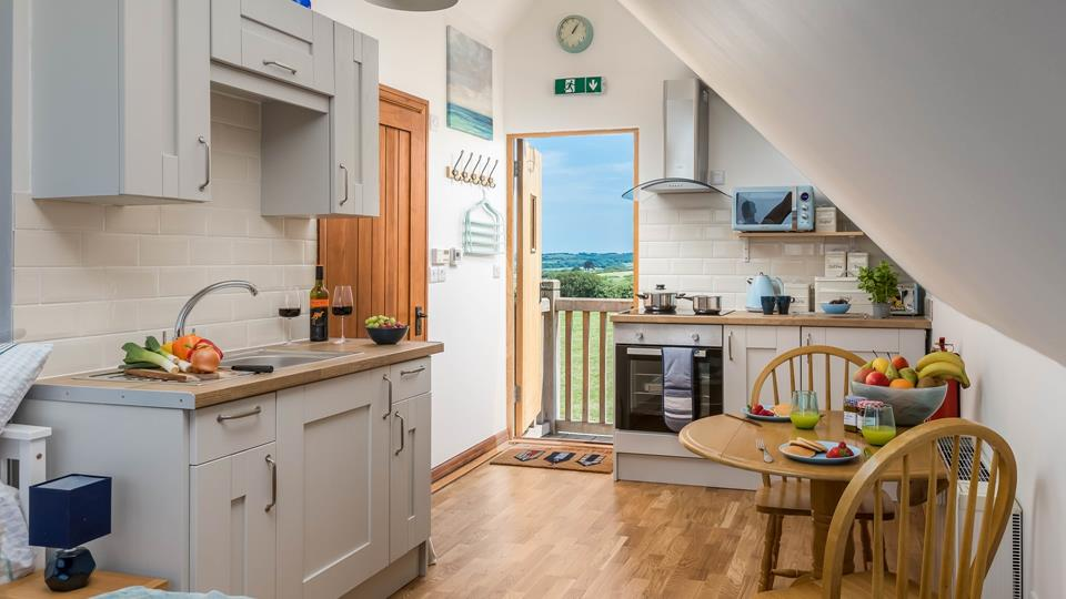 The open plan layout makes clever use of the loft space, and with the entrance door open, you'll enjoy far-reaching views across the beautiful countryside.