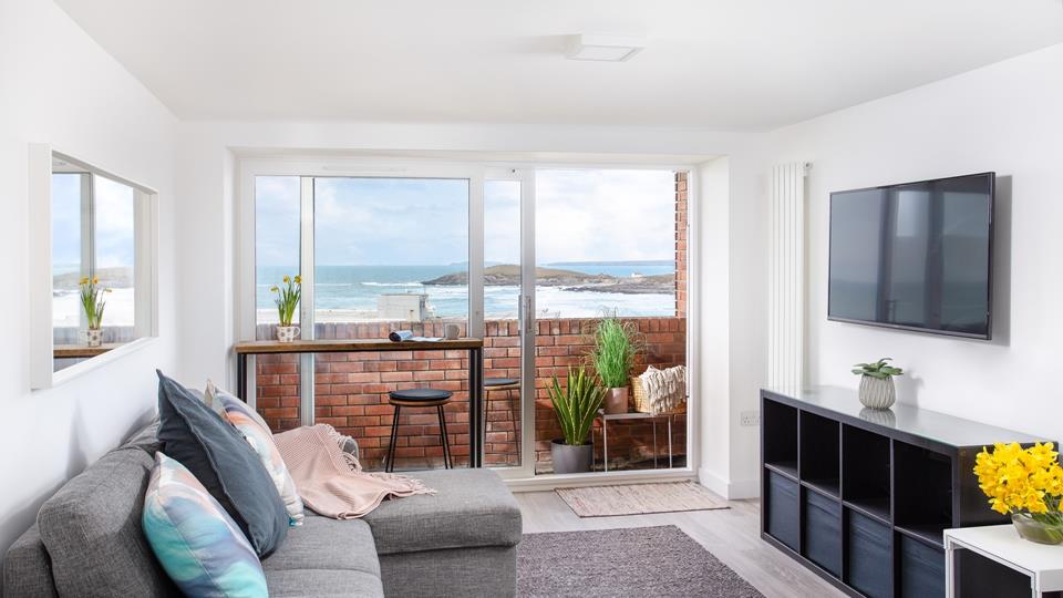 Sit with a cup of tea watching the surf from the breakfast bar looking towards Fistral beach.