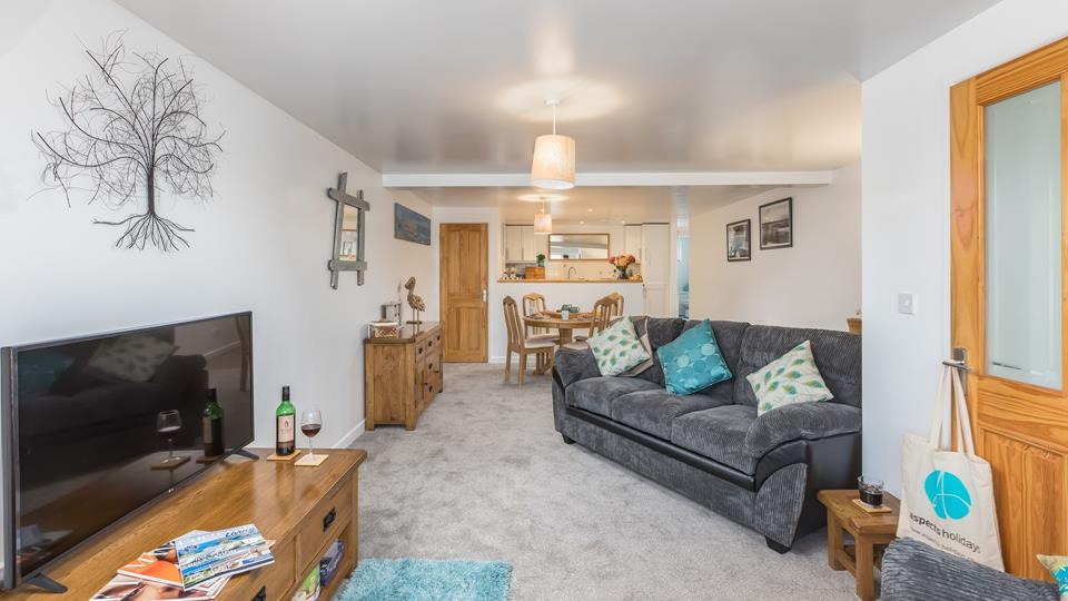 The living space is well designed, creating a large and roomy open plan sitting room with dining and kitchen area to the far end.