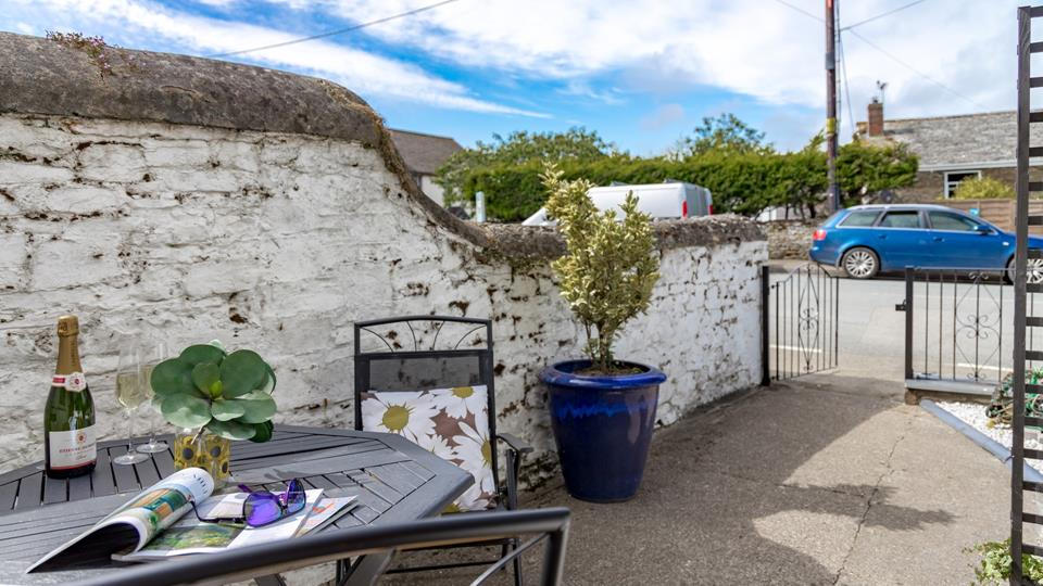 There is on-street parking available just outside the property, the property is accessed conveniently through the wrought iron gate from the courtyard area.