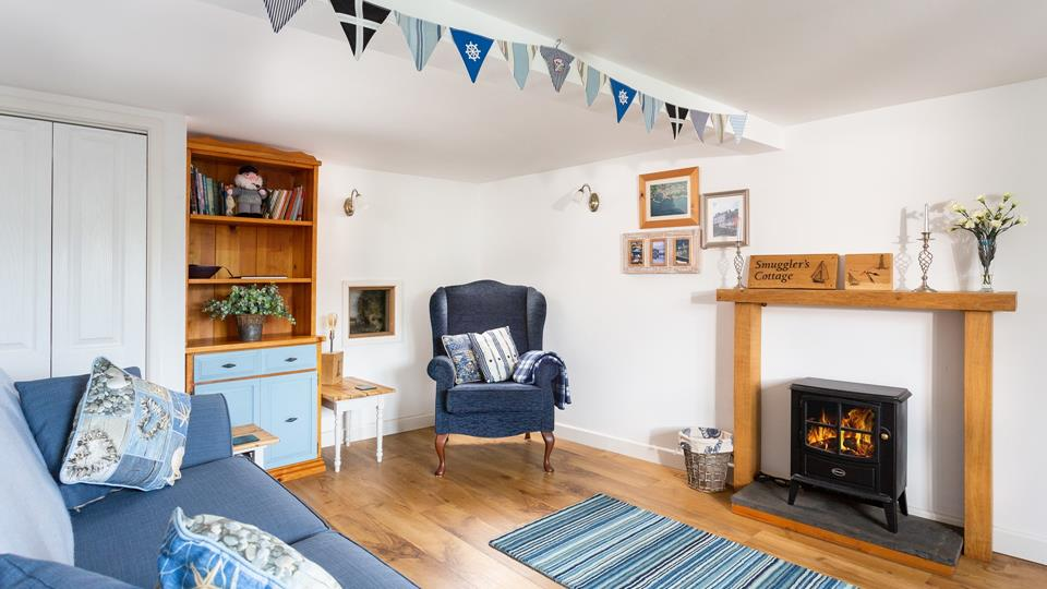 Cosy up in the cottage living room with underfloor heating.