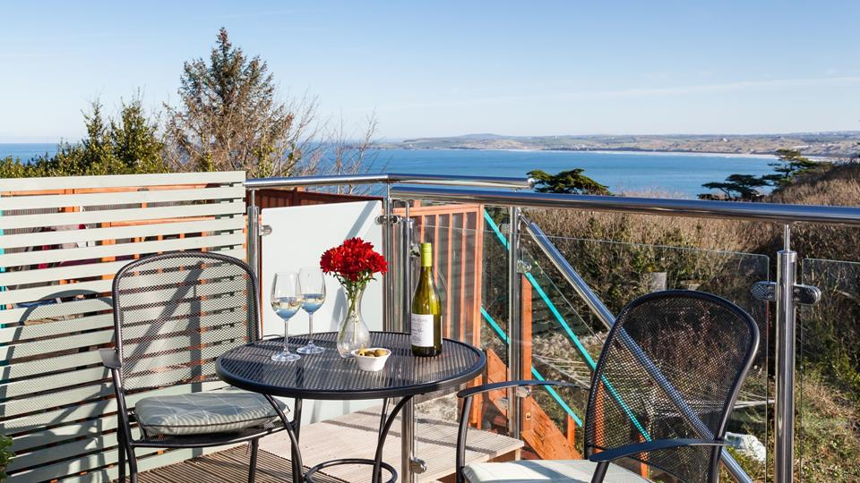 Relax and take in the stunning views across Carbis Bay and towards  Hayle.