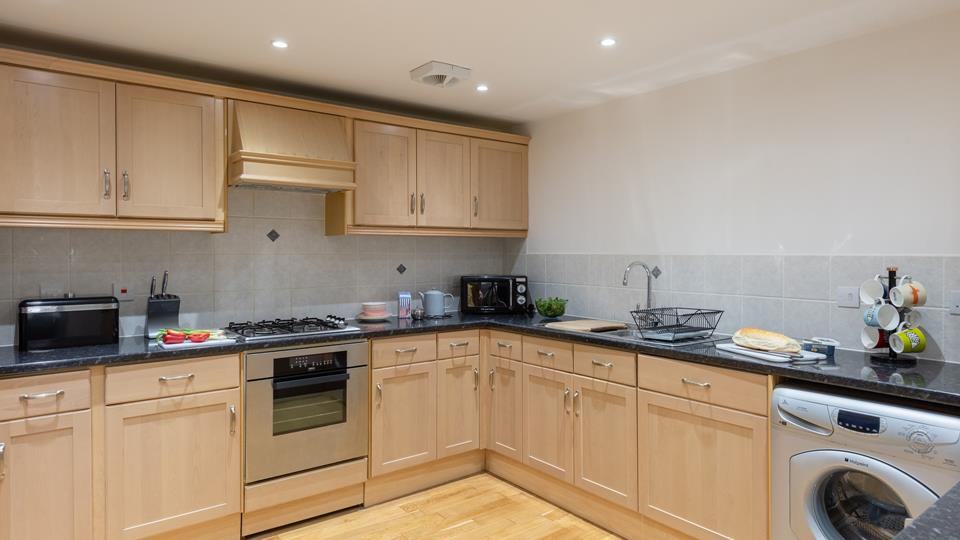 The kitchen has all the home comforts you need for a homely holiday by the sea.