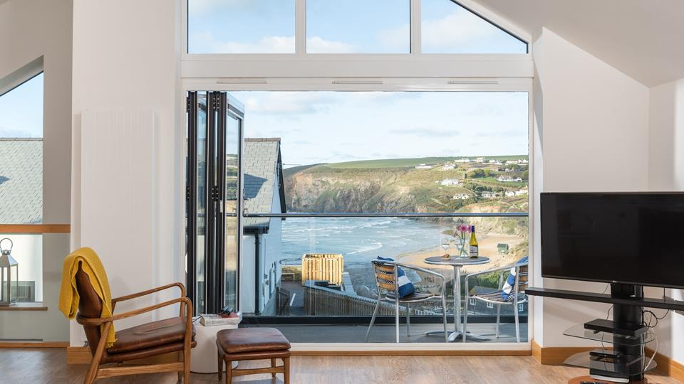 Bi fold doors lead out from the open plan living space, to stunning views of Mawgan Porth and the surrounding valley.