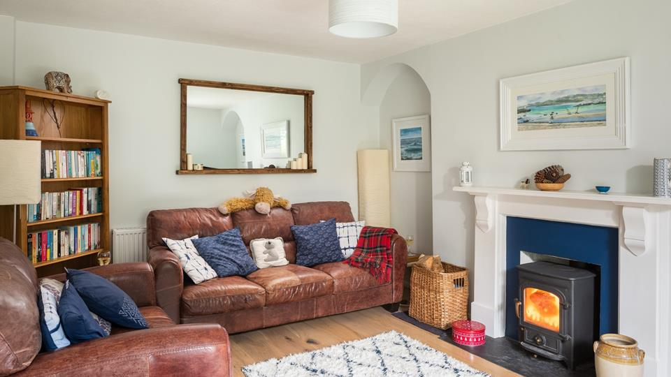 Cosy up by the log burner with the family.