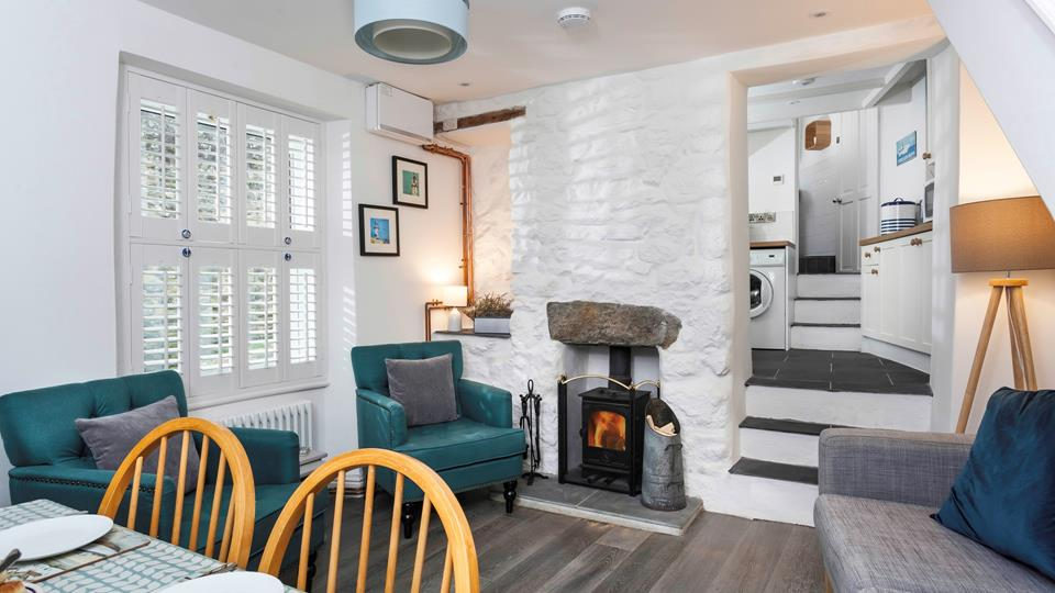 Sit back and relax in front of the roaring wood burner, perfect for warming yourself back up after a fresh beach walk.