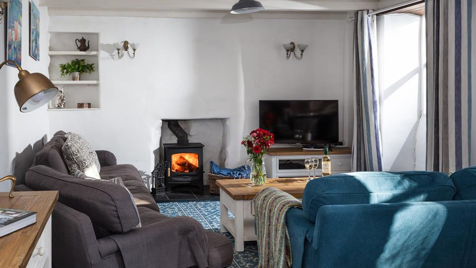 Snuggle down with a glass of your favourite wine in front of the cosy woodburner.