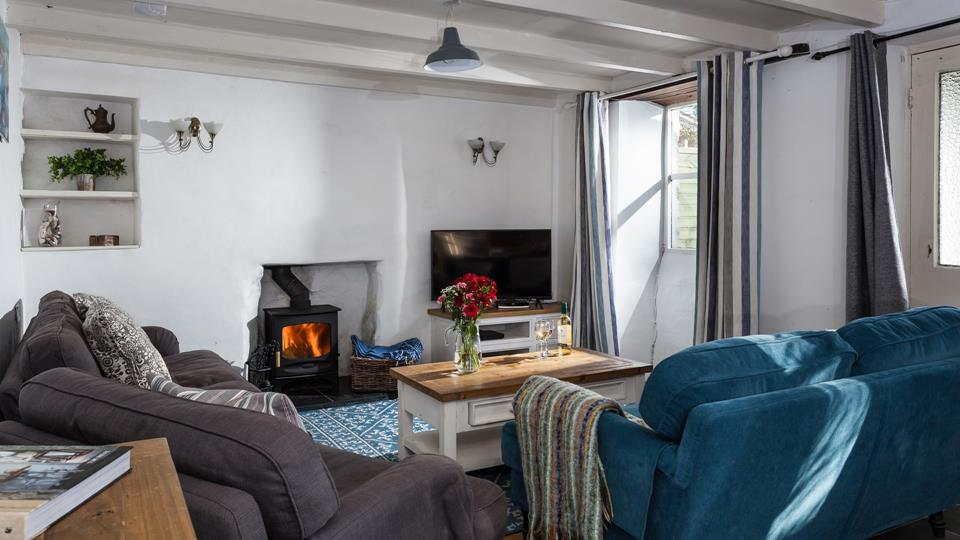 Sink into the comfortable furnishings ar Rockhopper Cottage.