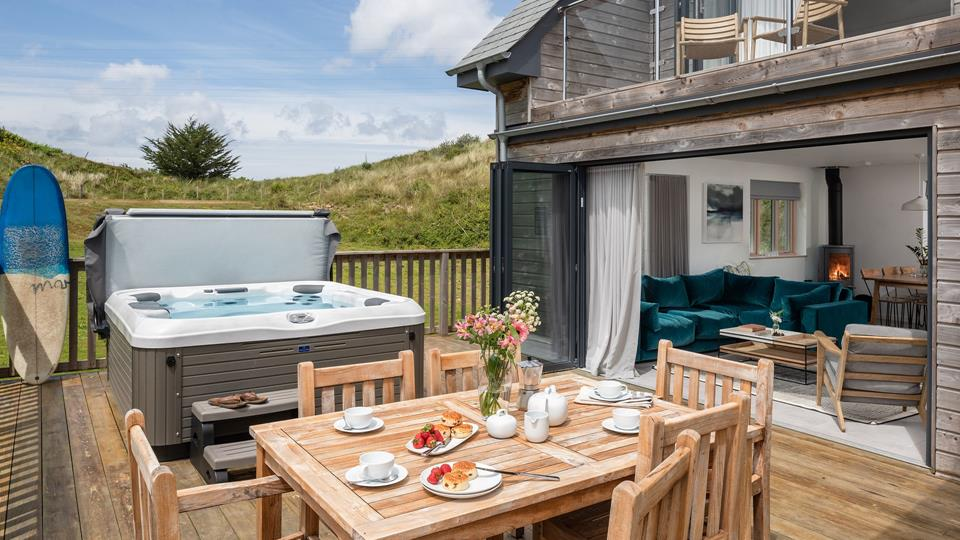 Enjoy al fresco eating on the deck sheltered by the sand dunes.