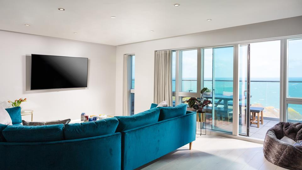 The open plan living area opens out onto the balcony, where you can watch the waves and listen to the sea.