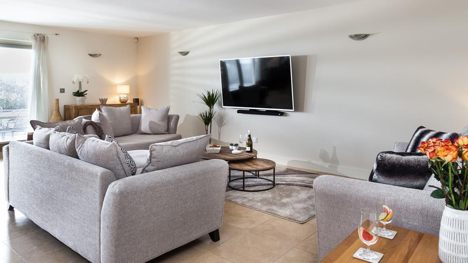 The living area is super cosy, with plenty of room for the whole family to chill out together and watch a film.