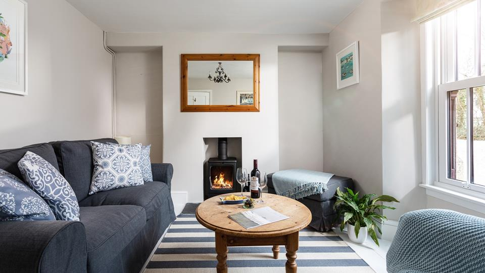 The snug looks out onto the front patio, so you can watch the comings and goings of this popular Cornish village.