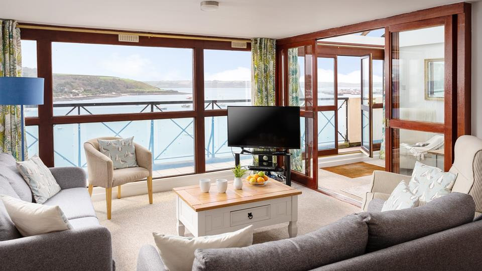 Sit back, relax and watch the boats meander across the harbour.