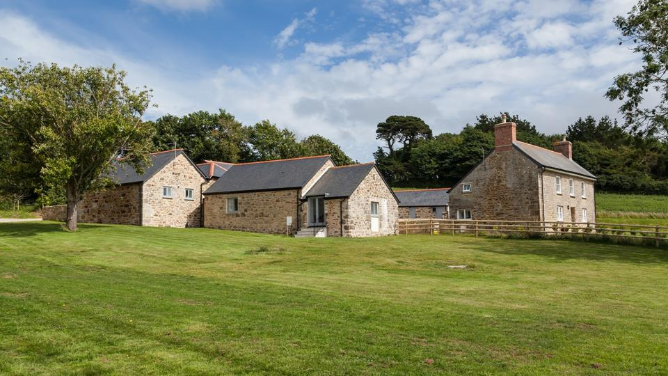 Frythens Farm buildings, Tillys House is behind Cherry Blossom Barn which is the barn in the foreground with the patio doors onto the meadow.