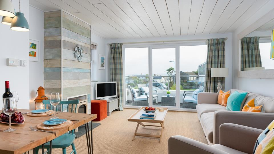 The lounge leads straight out onto the balcony where you have wonderful sea views.