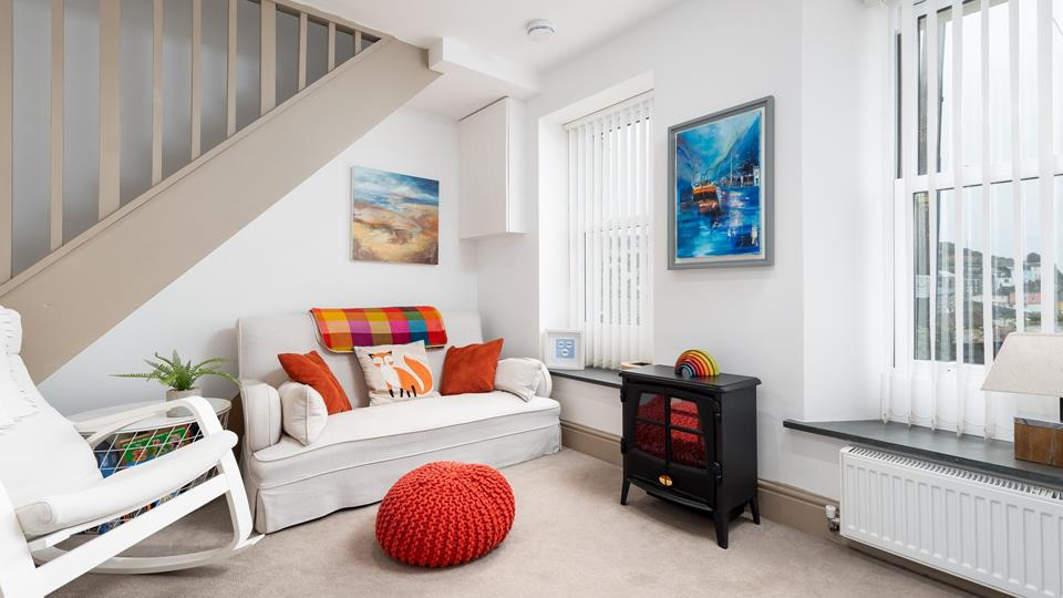 Bright colours mix with cream and blue in the lounge, capturing all the fun of a day out at the seaside!