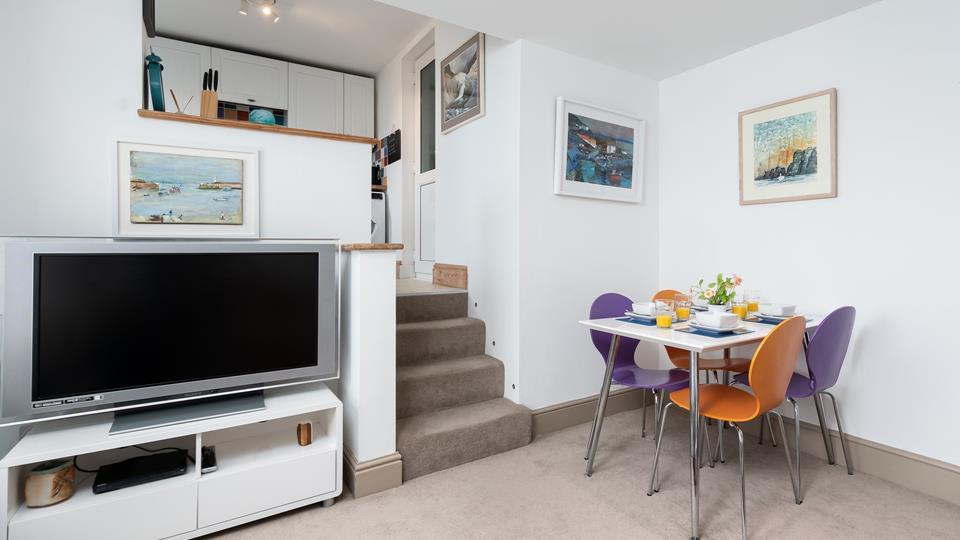The retro dining area offers plenty of space for the whole family to gather together for delicious meals!