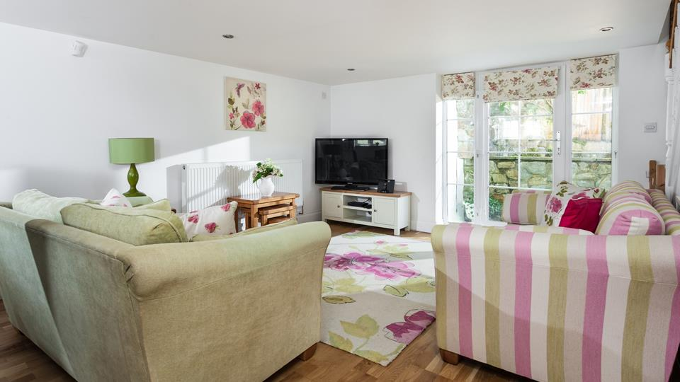 Pretty pastels and sweet florals make the lounge appear as though it is straight out of a fairytale!
