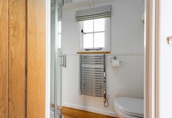 Start your day with an invigorating shower in the modern, country chic bathroom.