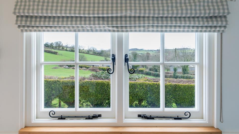 Cute cottage style windows look out on the stunning rural views!