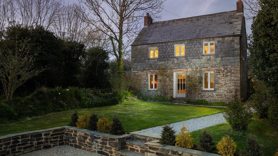 A quaint stone cottage that looks as if it is straight out of a fairytale, Waverley Cottage is nestled in the pretty hamlet of Burlawn.