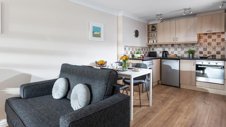 The open plan kitchen/lounge area provides a cosy base.