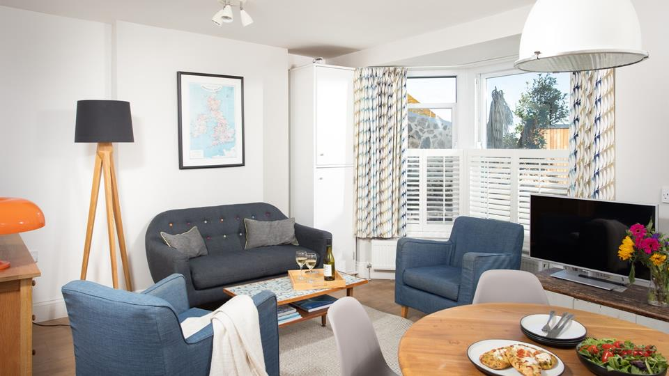 Soft seaside tones have created a relaxing haven where you can enjoy an evening of films and games.