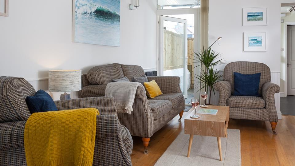 The living area blends a mixture of colours and textures to create a homely space with seaside holiday vibes.