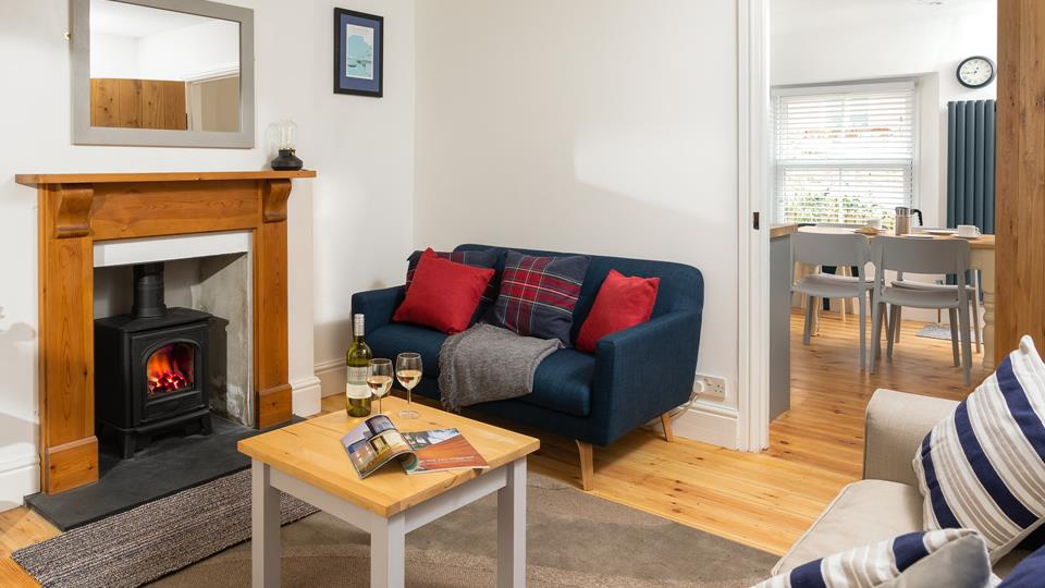Rich colours and a cosy woodburner ensures the lounge is an inviting place to curl up in on cooler evenings.