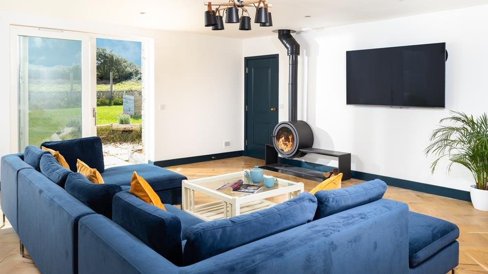 Relax on the sumptuous sofa in front of the fire on a chilly autumn evening.
