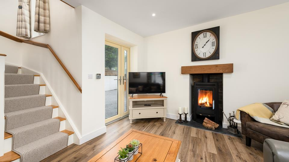 A woodburner and warm tones have created a homely feel, welcoming you inside after a day of adventures.