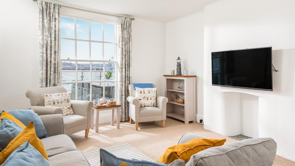 Decorated in fun seaside hues, the lounge offers a cosy space to cuddle up for a family film night!