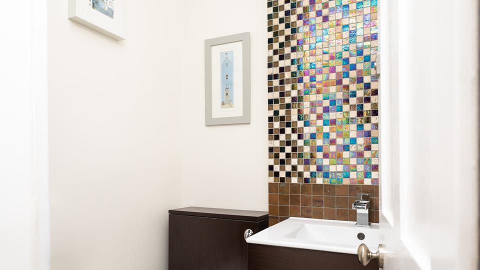 The property benefits from a cloakroom, allowing you to quickly freshen up before heading out.