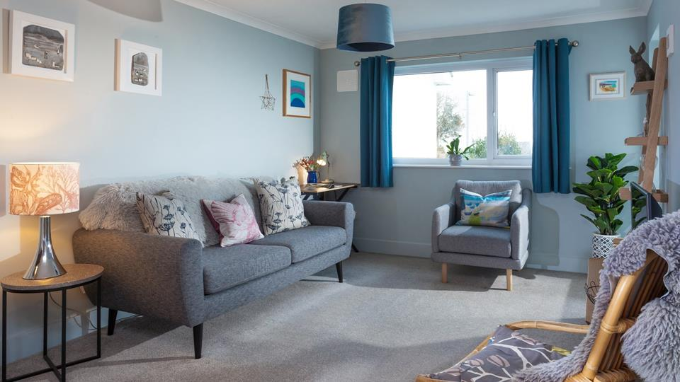 Bright and spacious, the sitting room is a comfortable and inviting space to unwind at the end of the day.