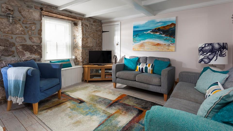 The sitting room perfectly combines traditional features with modern and colourful decor.