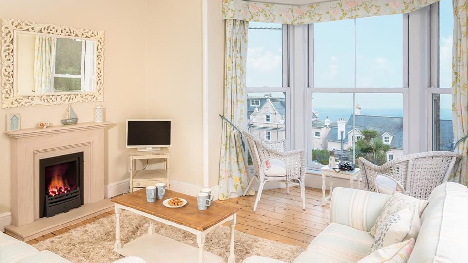 Relax in the sitting room, looking out over the views in the summer or in front of the fire in the colder months.
