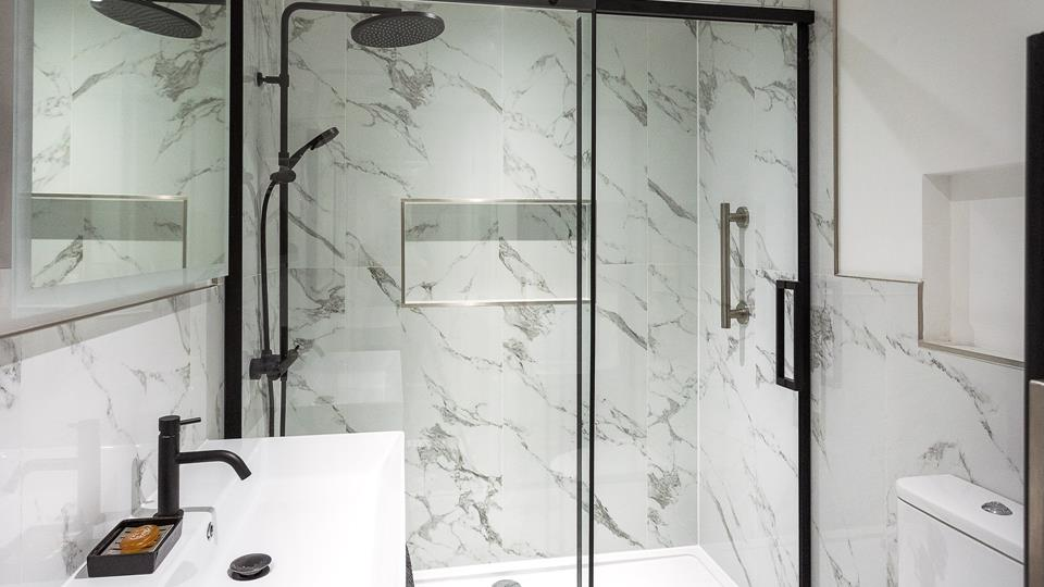 Start your morning with an invigorating shower in this absolutely stunning bathroom.