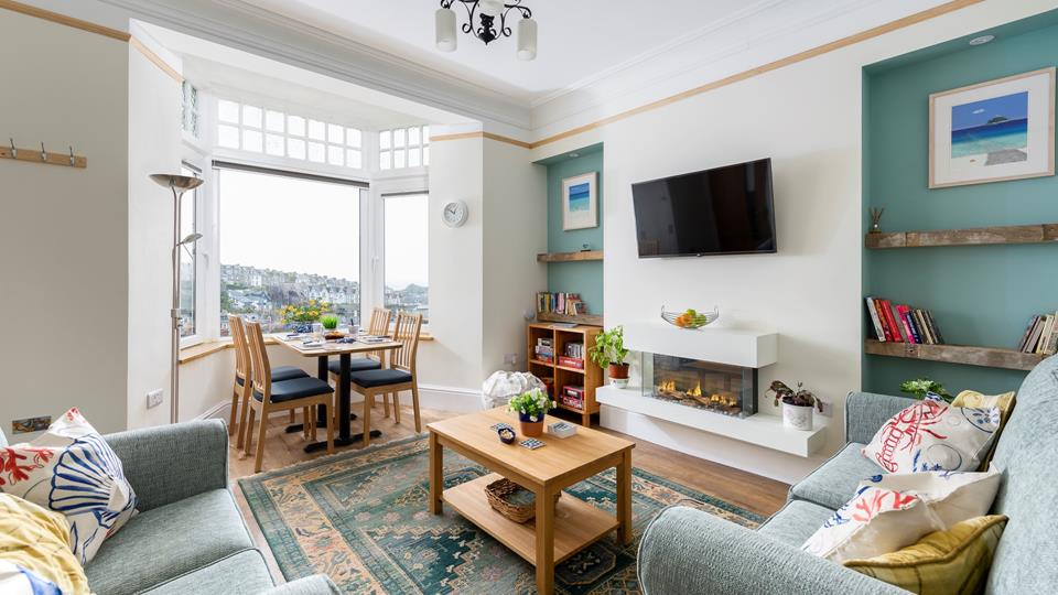 The calming sitting room is perfect for a small family to relax in, no matter what time of day.