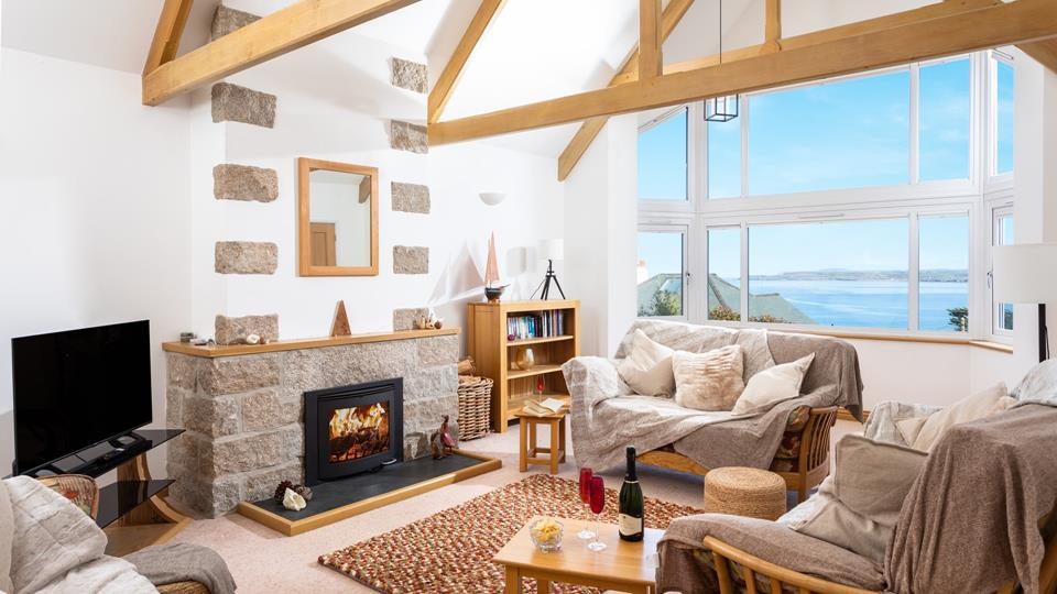 You'll be blown away by the exposed A-frame beams and dreamy sea views.