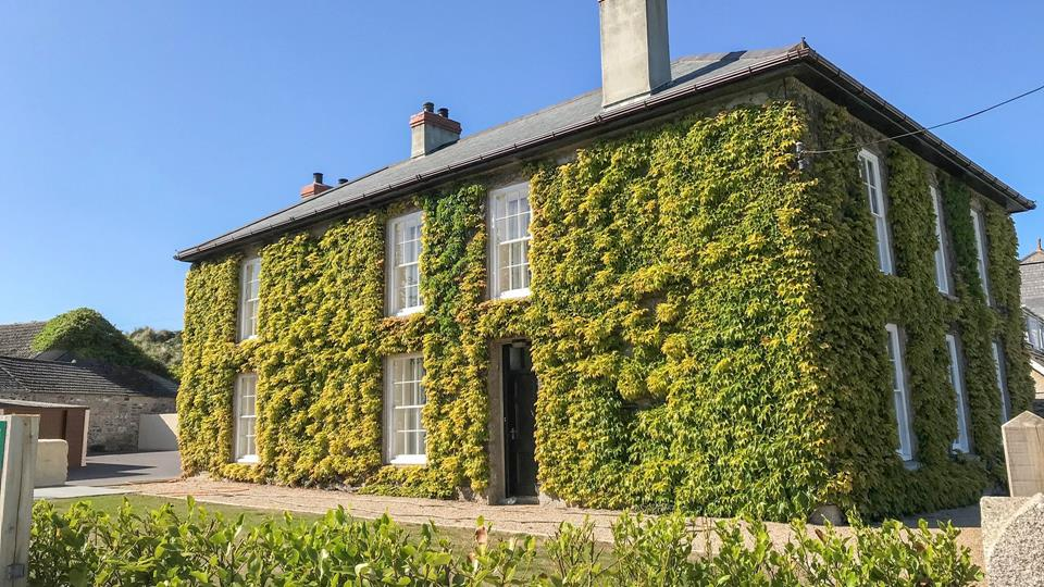 Grande and inviting, the ivy-covered Churchtown Farmhouse commands an enviable position in Gwithian.