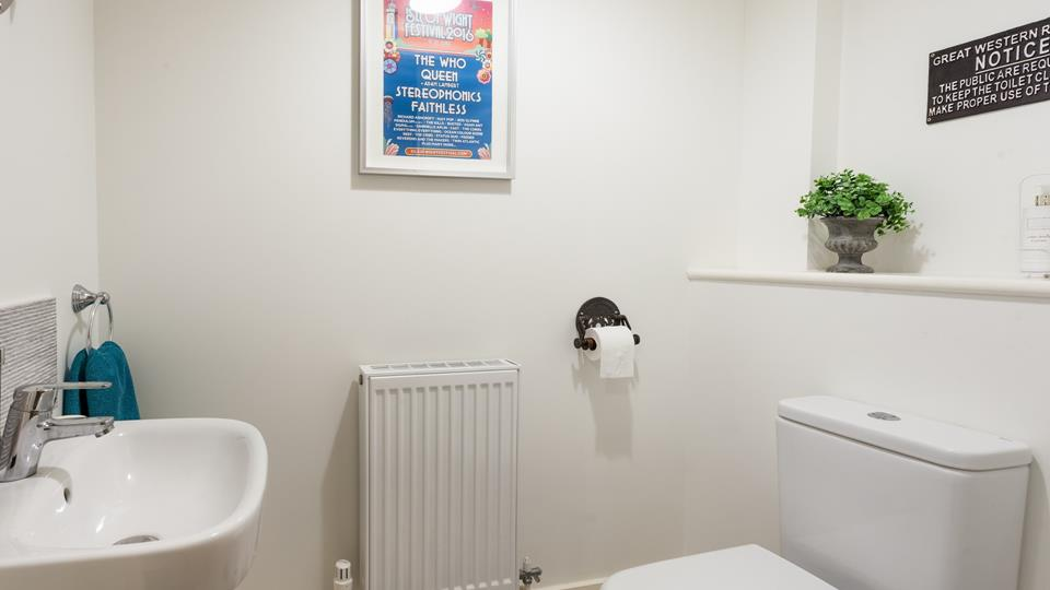 The property has a handy cloakroom to quickly freshen up before you head out.
